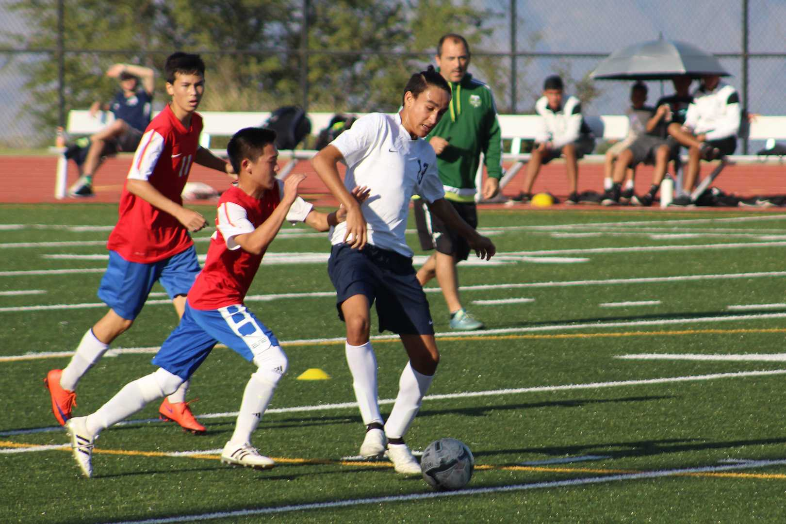 Sophomore Aikalaokekainalu Chappell keeps the ball under control from the Lunas. The jv boys gained their third consecutive win with a 4-0 rout of the Lunas.