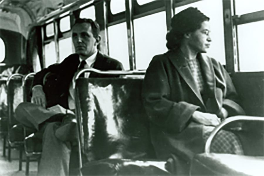 Rosa Parks became famous for her refusal to move from her seat for a white passenger, Dec. 1, 1955. This photo was taken at a later time.