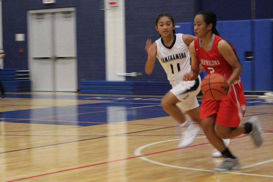 Kamehameha Maui's Brylee Carillo chases Luna Sheilaika Agbayani, down the court at Kahekili Gymnasium, Dec. 13. The Lunas came out ahead in the teams' first match-up this season.