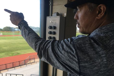 Athletic Director Patrick Higa explains how the control panel for the lights work, and shows which light each dial corresponds to.