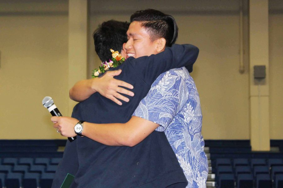 Kaimana+Idica+hugs+admission+counselor+Matthew+Wong+after+accepting+the+HPU+scholarship.