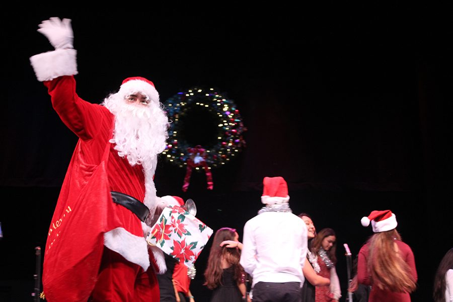 Santa Claus makes an appearance during a performance by the high school choir at the annual Christmas concert in Keōpūolani Hale, Dec. 8.
