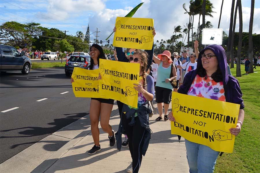 Allies for Equality members march for women's rights Saturday morning, Jan. 21, along Kaʻahumanu Avenue.