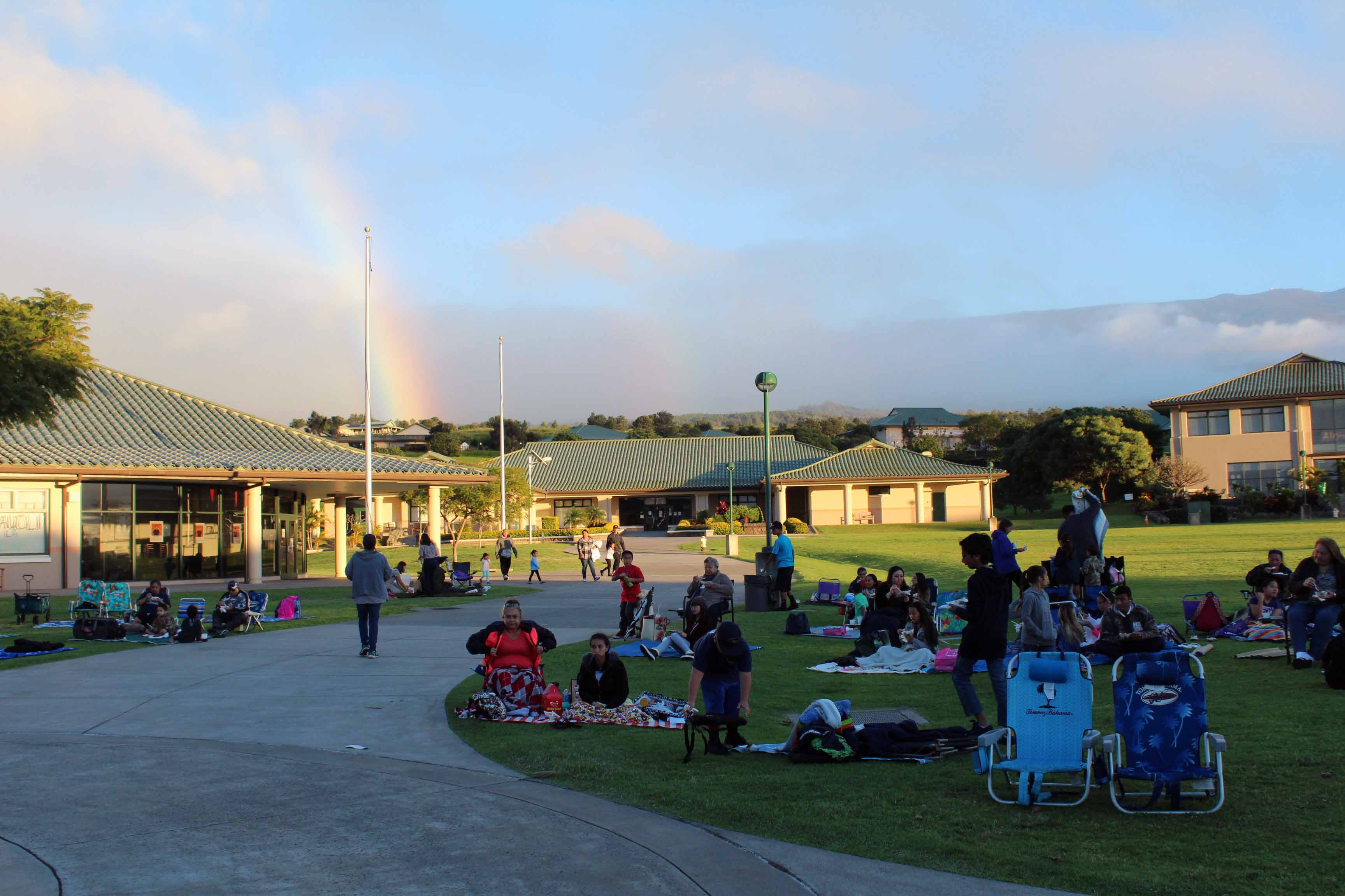 Families and friends lay out their blankets and chairs for the all-school movie night hosted by the PTSO. The event took place outside Keʻeaumokupāpaʻiaheahe on Saturday, Jan. 28.
