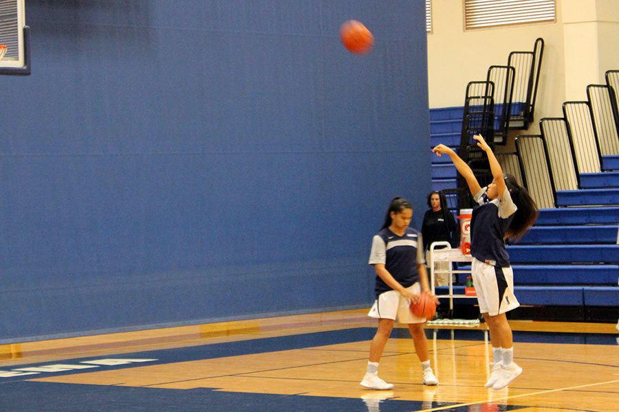 Freshman%2C+Tatianna+Soon+practices+her+shots+before+the+game.