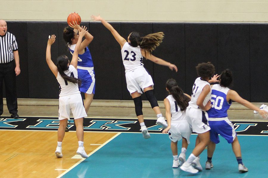 Kamehameha Maui's Kaylee Cambra and Mikiala Sniffen block senior Tupou Lavaka in their semifinal match against Maui High School, at King Kekaulike High School, Jan. 26. The Warriors won 36-25, and will advanced in the MIL tournament, while earning a spot at the HHSAA state tournament.