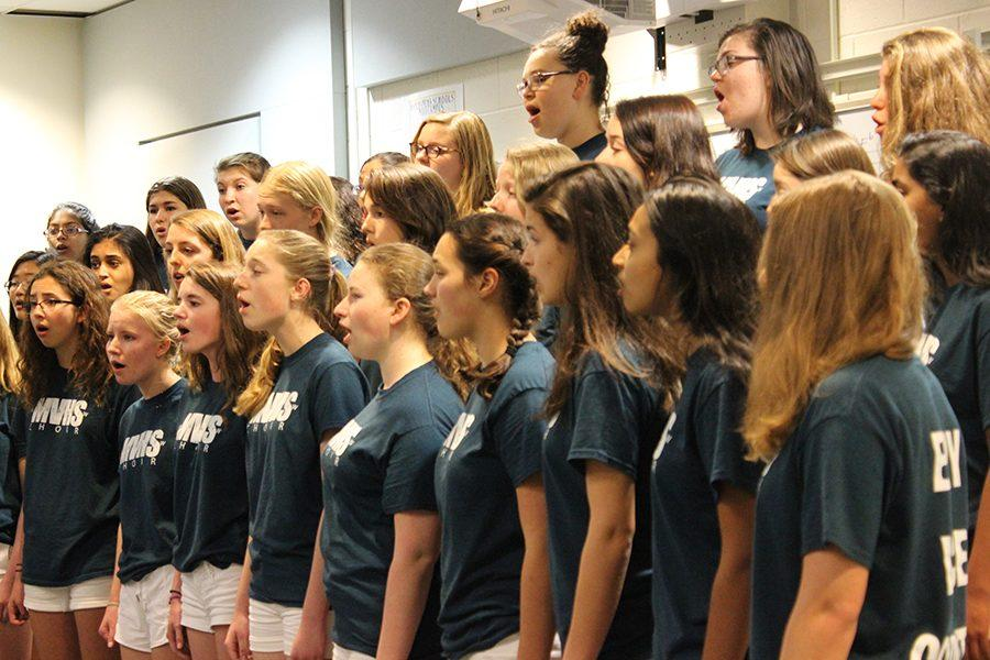 The Mountain View High School all-girls a capella choir performs songs for various KSM students on Feb. 23 in Mr. Dale Nitta's classroom. This select choir sings a variety of genres and performs across the United States to connect others through music.
