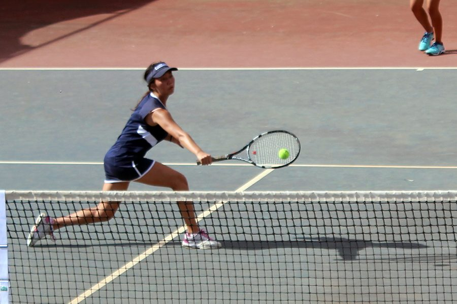 Freshman+Ailana+Suehiro+hits+with+her+backhand+at+the+net.