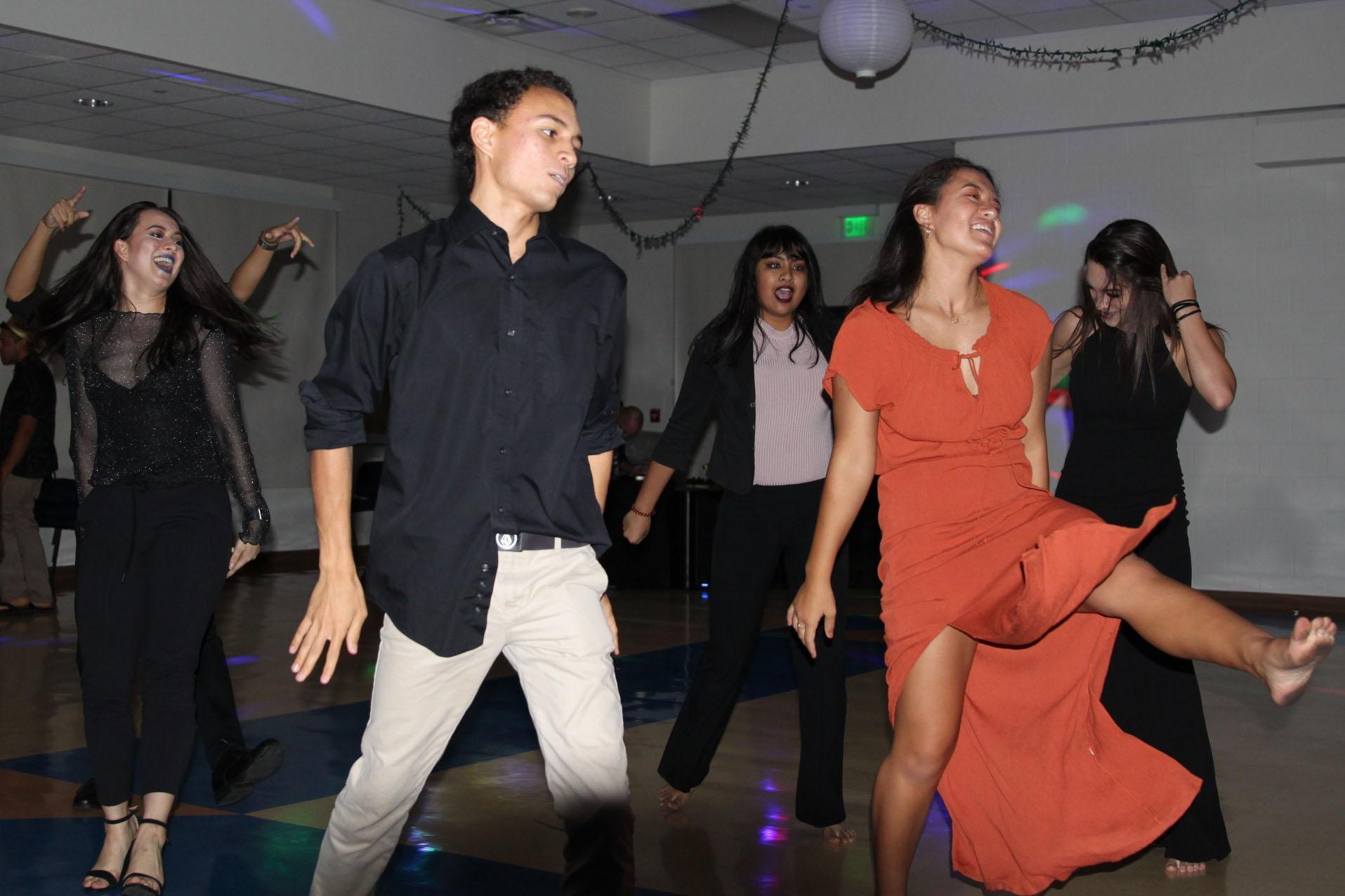 The senior class's Kamehameha's Best Dance Crew re-preform their step routine for their classmates and guests  at their last formal, the senior ball, Saturday, March 11 at Kuakini Dining Hall.