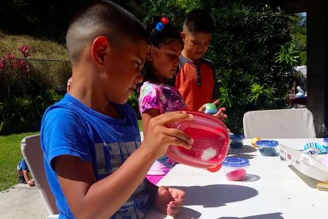 Each child was able to decorate their own egg using the tupperware filled with rice and food dye.