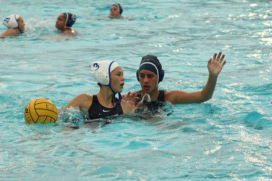 Junior Madison Dutro blocks during KSM water poloʻs last game of the season against Seabury Hall, April 20.