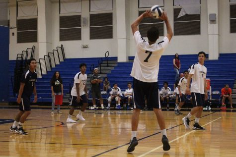 Senior Keahi Jacintho sets junior Austin Peters for a spike while senior Hanalei Alapai gets ready for a fake.