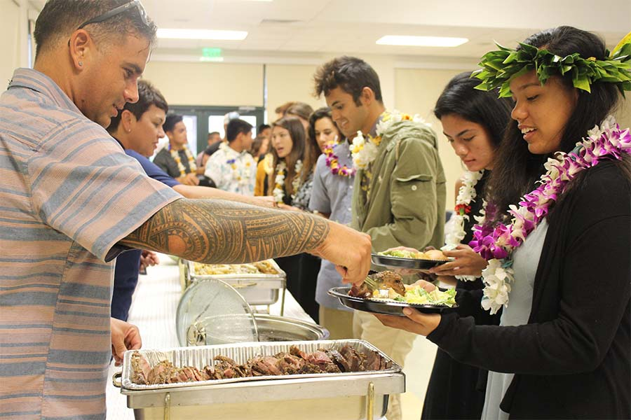 Junior Ashley Peralta grabs some dinner served by parent volunteers and staff at the first KS Maui Athletic Banquet at Keʻeaumokupāpaʻiaheahe dining hall May 17.