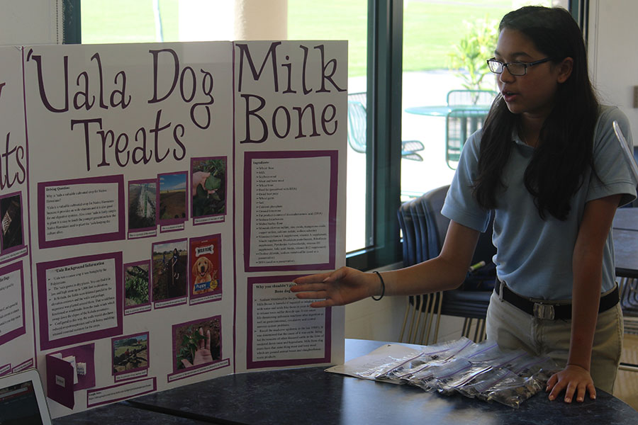 The freshman biology class presented their ʻuala projects at the ʻuala fair in Keʻeaumokupāpaʻiaheahe dining hall Thursday, May 18, 2017. Sierra Tanouye presents her project on healthy dog treats to Ms. Holderbaum.