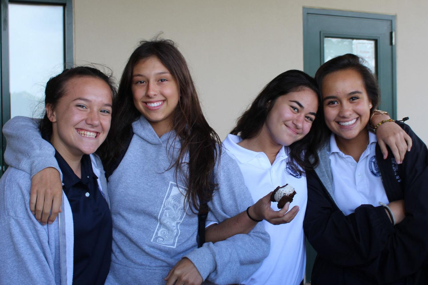Seniors Chloe Lawrence and Nāpua Gushiken hang with their freshman siblings Kalia Franco and Laʻakea Awai. Cruisin' in the Quad gave freshmen the chance to meet their senior sibling while bonding over ice cream.