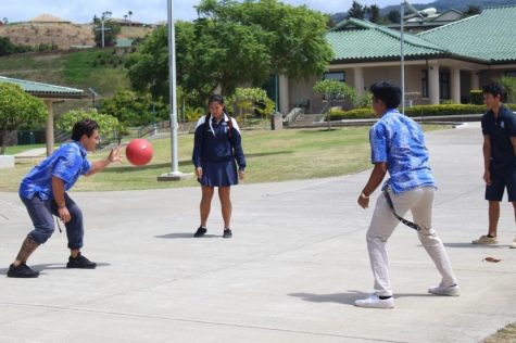 Senior Kiha Mossman passes the ball in a game of four-square.