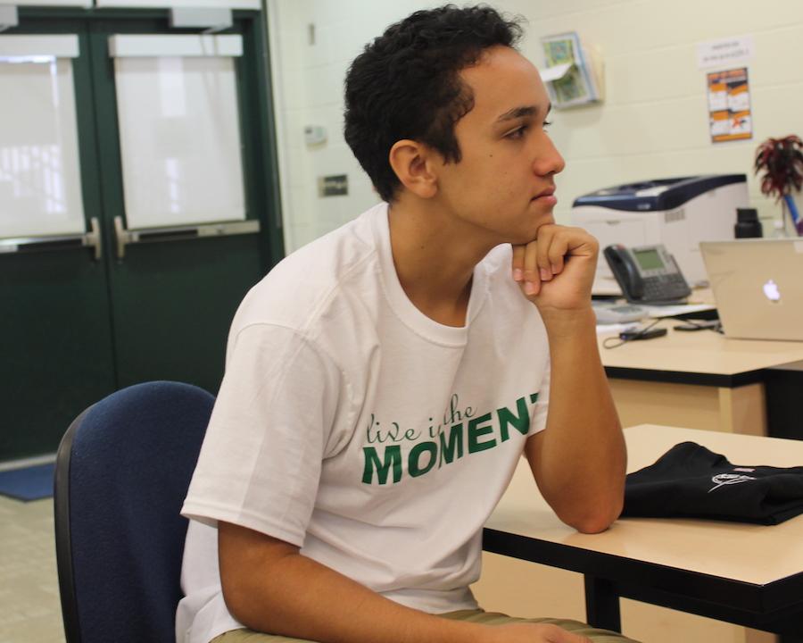 Junior Maverick Akana sports his class t-shirt on Homecoming Day.