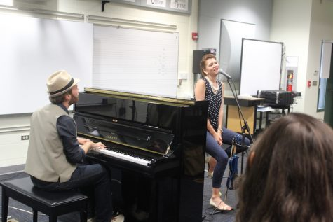 Ariana Andris and Ivan Danylet sing and play music in the choir room. The professional singers were invited to perform for select students by Kumu Kalei Aarona-Lorenzo.