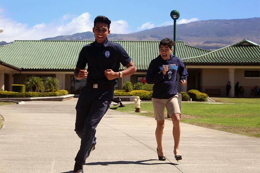 Senior Michael Singh passes freshman Jonah Saribay as they make the run for the finish line. Kamehameha Schools Maui hosted a Walk a Mile in Her Shoes event Oct. 19.