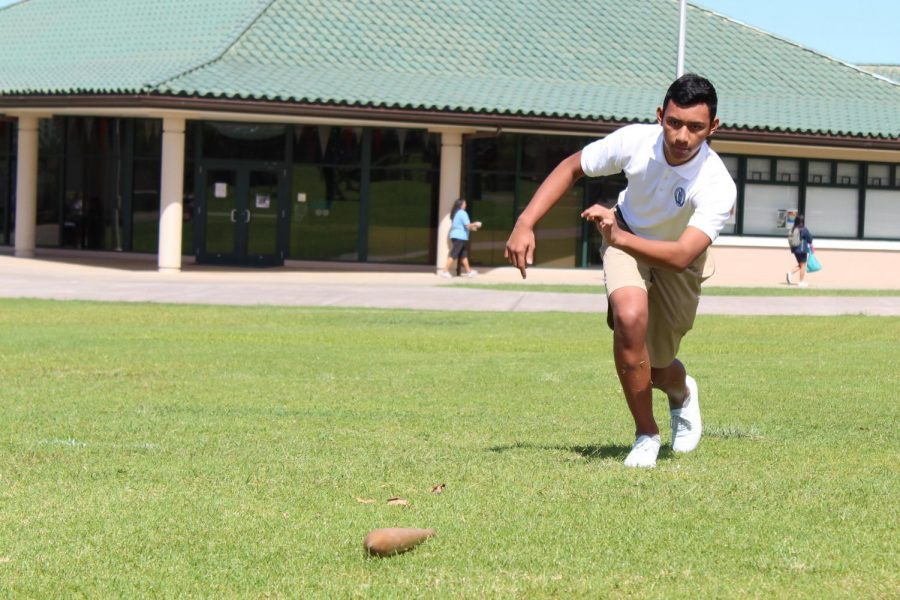 Freshman Kihaapi'ilani Kahalehau competes in the Moa Pahe'e game against his classmates. Haumāna within their papa competed against one another to place first and move on to the final round against the other classes.