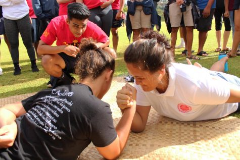 Senior Michael Singh hosts ʻuma with competitors Kuaola Emmsley and Pōmaikaʻi Tompson facing one another.