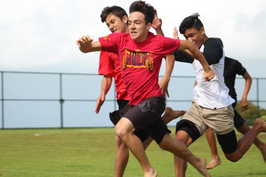 Junior Lee-Joseph Franco competes for first in heihei wāwae. Nowemapa 22 was the final round of competitions for Makahiki with several other schools coming on campus to compete.