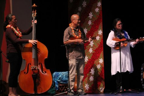 Kumu Kalei, and Mr. and Mrs. Nitta play three mele for the kula waena choir.