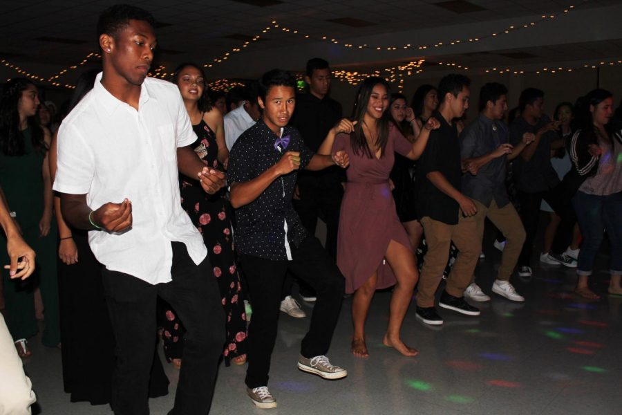 Senior Tyerell Baldando-Kaleiopu leads the dance line. Winter Ball brought all four grade levels together for a night filled with fun before winter break.