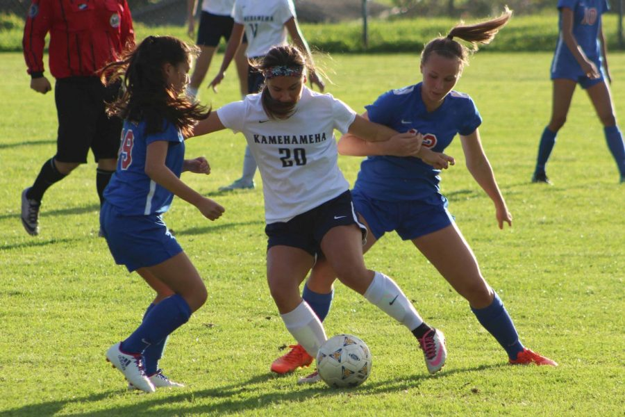 Senior Kamalei Roback defends the ball during the first quarter. The Kamehameha Schools Maui girls soccer team won, 4-1, against the Spartans at Seabury Hall, Saturday, Dec. 30.