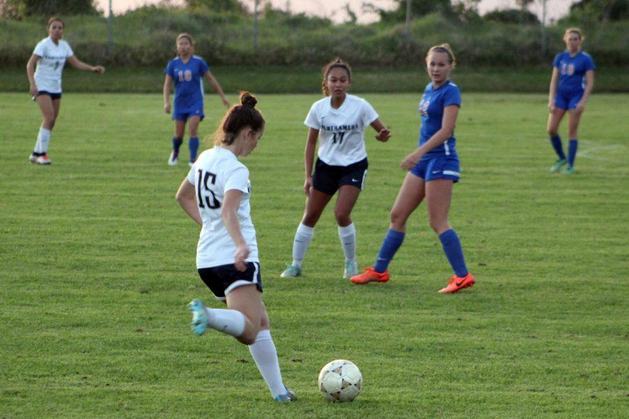 Sophomore+Lilia+Wietecha-Davis+passes+the+ball+to+a+teammate+closer+to+the+net.