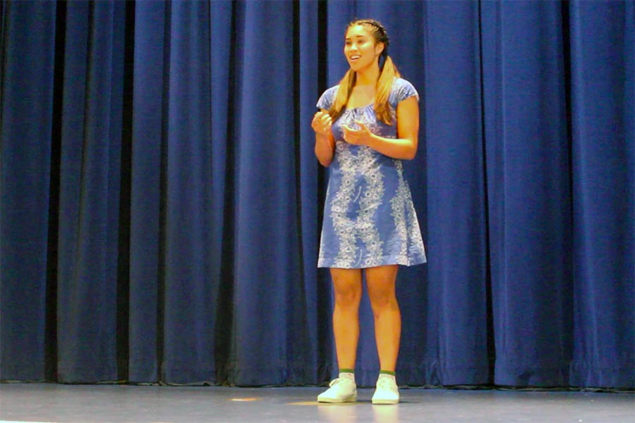 Senior Mikaela Bega performs her poem,