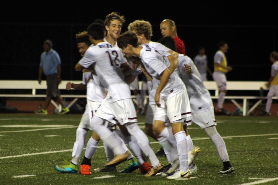 The+Bears+celebrate+after+senior+Angelo+Deloso-Flocco+scored+a+goal.