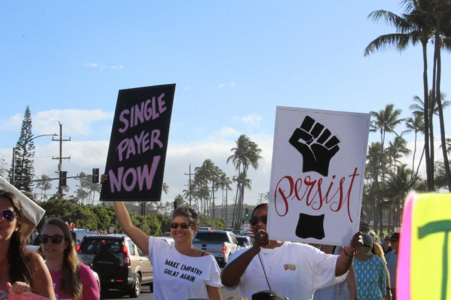 The+march+empowered+women+to+stand+up+for+changing+the+world.+Signs+of+all+colors+and+words+empowered+women+all+over+Maui.