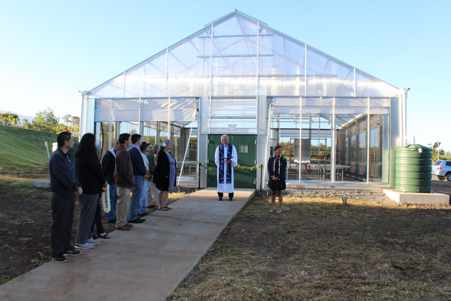 Staff, groundskeepers, administrators, and haumāna witness the opening of Hale Uliulimau. The ceremony included an explanation of the name, a blessing and the cutting of a maile lei.