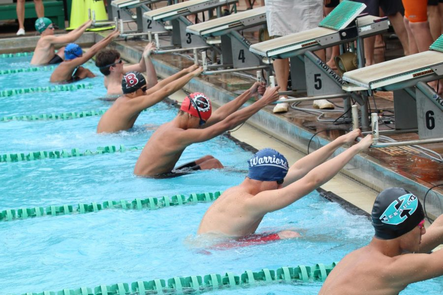 Senior+John+Williamson+gets+ready+to+take+his+mark+for+the+200+medley+relay.