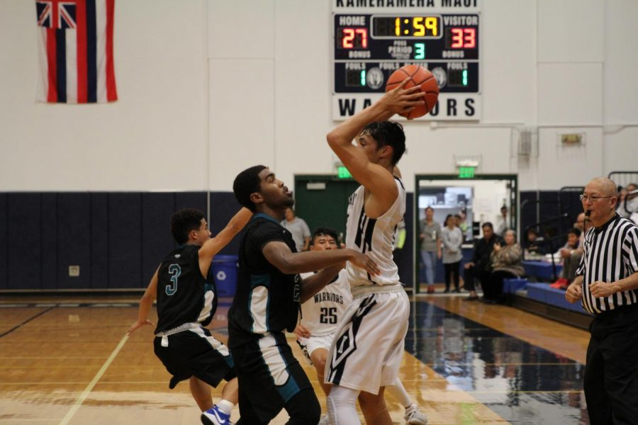 Kapolei junior Ja'shon Carter guards Junior Kamalu Segundo at the Snapple Boys Basketball Championships, Monday, Feb. 12, at Kaʻulaheanuiokamoku Gym. The Hurricanes won and advanced in the tournament, ending the Maui Warriors' journey to the state finals in the first round.