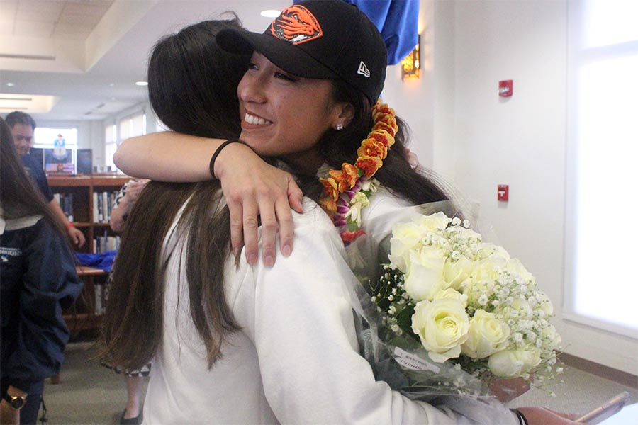 Seniors ʻIlihia Keawekane and Kyana Nagasako hug after Keawekane signed an athletic letter of intent to play soccer for Oregon State University. On Feb. 1, seniors Keawekane and Aliah Ayau signed into West Coast colleges with family and friends supporting their step into a new journey.
