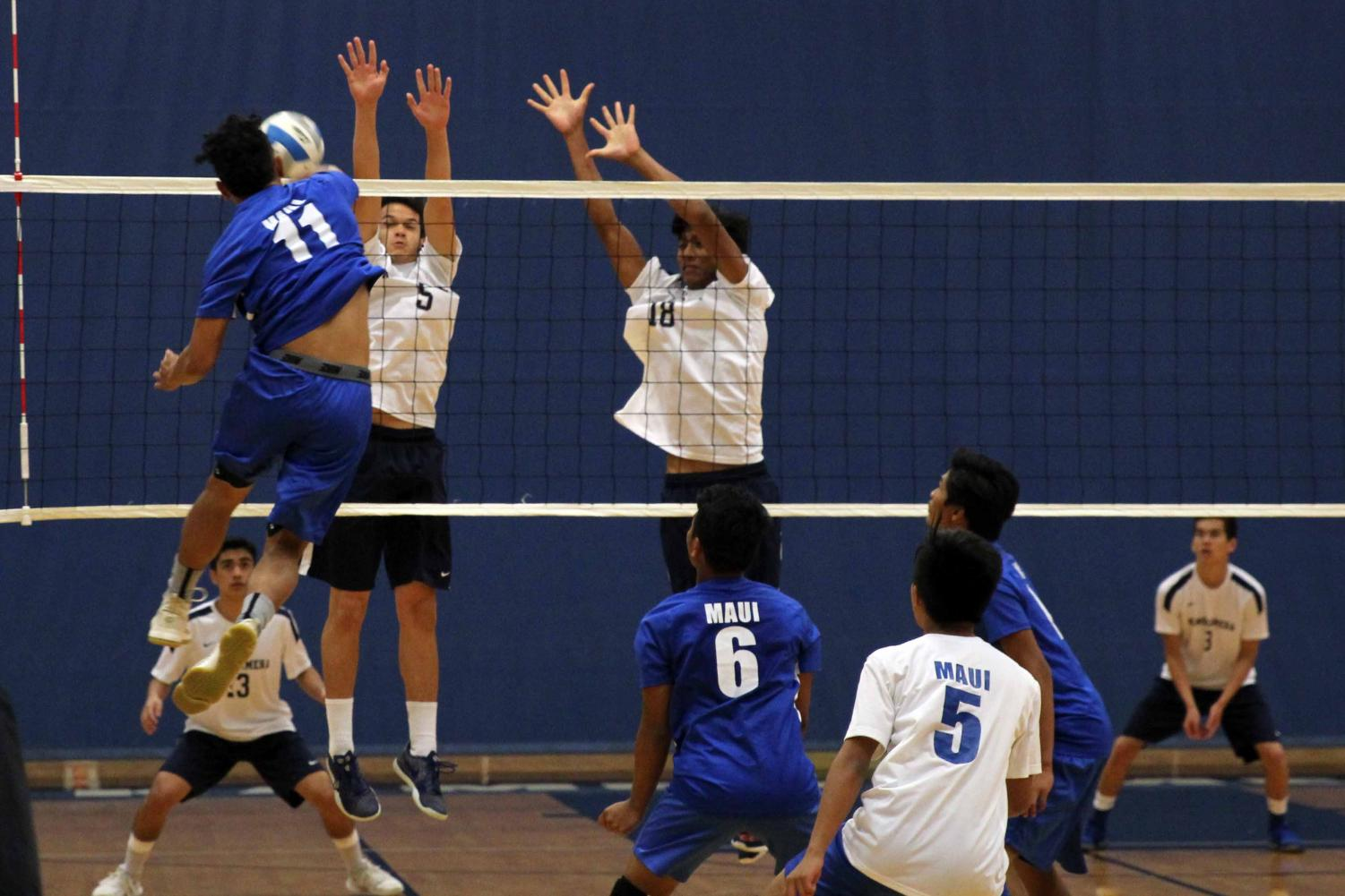 Sophomore+Ethan+James+and+senior+Rafael+Adolpho+get+ready+to+block+the+ball+from+their+opponent.+