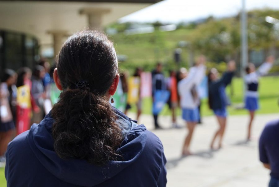 Kumu Kalei ʻAʻarona-Lorenzo watches as haumāna give their aloha through hula to the victims of the Marjory Stoneman Douglas High School shooting. It was one aspect of a 17-minute memorial, part of the National School Walkout, March 14.