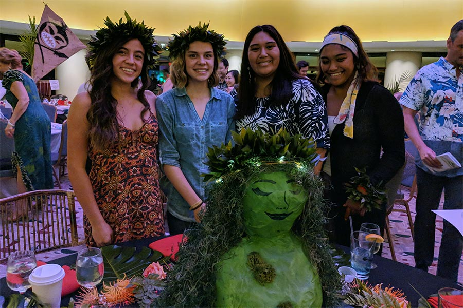 Korey Cadiz, Kawai Kupuni, Hoala Alapai, and Maui High senior Kealani Alapai with the centerpiece of their award-winning table design. On Mar. 11 at the King Kamehameha Golf Club, these four high school students designed a table for the 21st annual Women Helping Women fundraiser. This year's fundraiser theme was Restoring the Heart: Hoʻokele Puʻuwai.