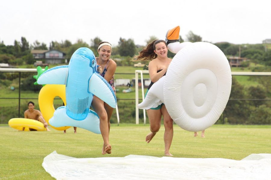 Stephanie Bodin and Lexi Figueroa take a running start for the 40-foot slip n' slide. Seniors enjoyed a day off from school, April 20, in celebration of their hard work in their senior year.