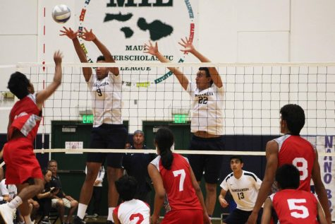 Sophomore Iverson Dudoit and senior Kahai Bustillos go up to block in the second set. The Warriors won 3-0 against Lahainaluna on their senior night at Ka