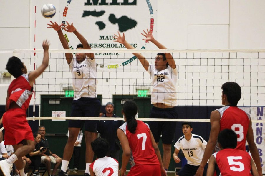 Sophomore Iverson Dudoit and senior Kahai Bustillos go up to block in the second set. The Warriors won 3-0 against Lahainaluna on their senior night at Ka'ulaheanuiokamoku gymnasium April 17.