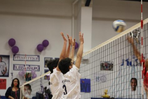 The Warriors put up a successful block against the Lunas at Kaʻulaheanuiokamoku Gym. The Warriors fell behind during the third set when the Lunas took the lead and won the game, April 17.