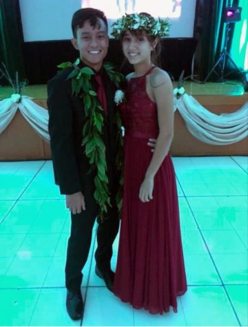 Prom King Henry Miguel and Prom Queen Seana Lanias smile together before they take the first slow dance of the night.