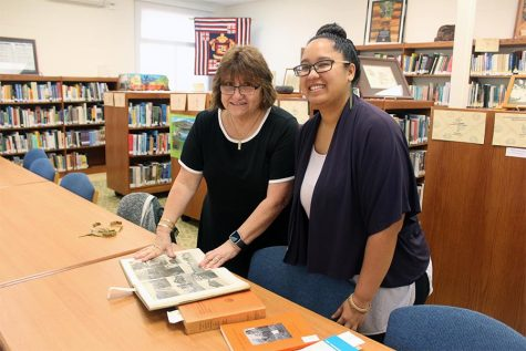 Mrs. Ho and Ms. Kauʻi Podlewski go over plans regarding the future of the Hawaiian room, which is being officially re-named Keaouli on May 16.