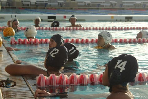 Sophomore Mahie Borge and teammates stop between drills for instructions. The water polo girls went 0-14 this season, including preseason.