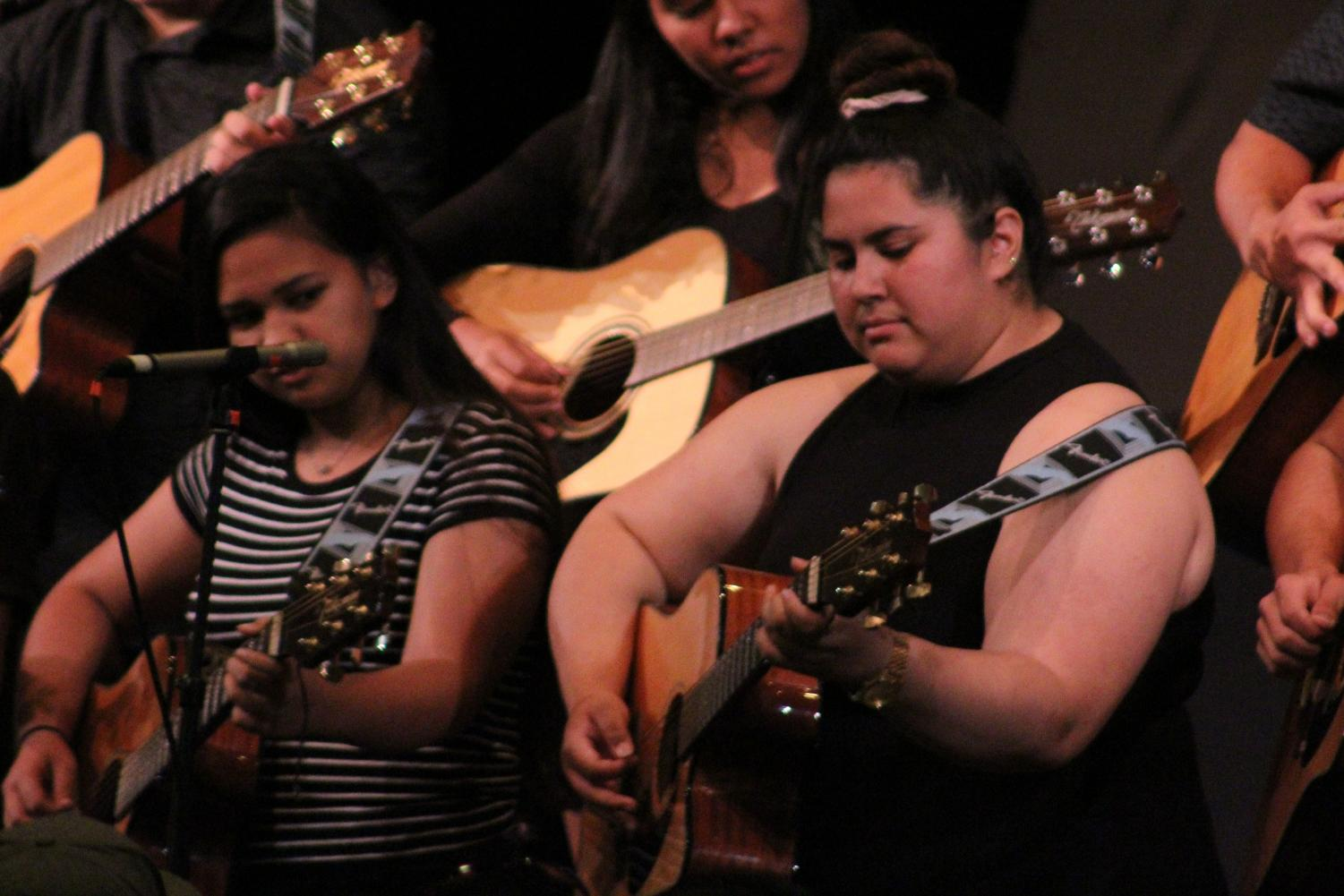 Senior Natalie Warrington plays guitar with the rest of the Guitar 1 class at the spring concert, May 10, in Keōpūolani Hale. The annual concert showcases the work of students in various performing arts classes.
