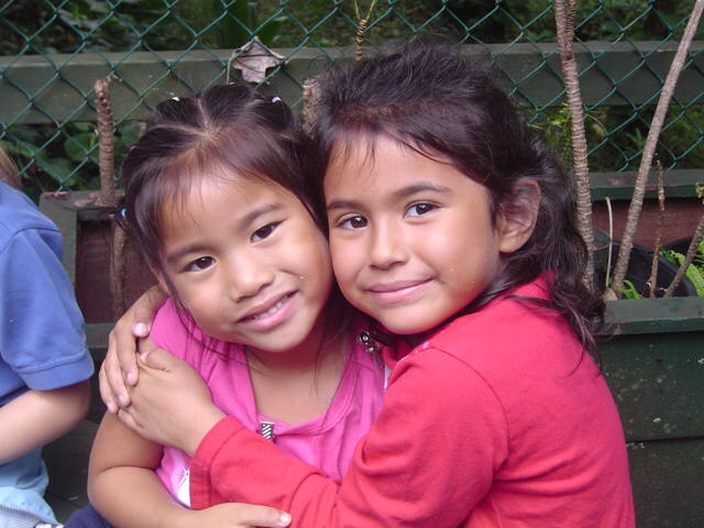 Tamashiro embraces classmate Natalie Warrington during their kindergarten year on a field trip to ʻĪao Valley.