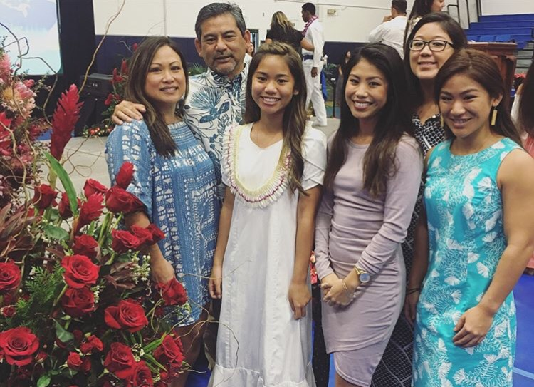 Kennedy-Kainoa takes a picture with her family at her last Founder's Day. She will be making a speech as one of four valedictorians at graduation on May 26, 2018.